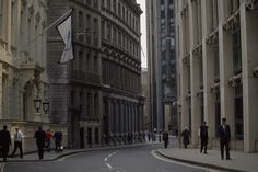 659304. Workers file through a London business center.Location: London, England.  Photographer: JODI COBB/National Geographic Creative