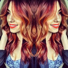 Medium deep red root to light red copper base with balayaged golden copper highlites. Haircut