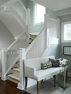 I love this staircase with the massive amounts of white trim and blue walls.