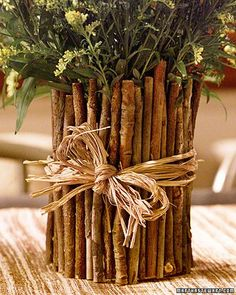 coffee can + twigs = vase could use cinnamon sticks, varied can sizes, and varied twig | http://bannerandgarland.blogspot.com