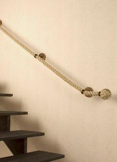 Straight Tight Rope Handrail -I like the tightness of the rope as it seems safer if you have to grab it