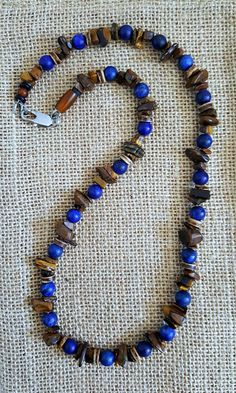 Men's blue and brown beaded necklace is designed with blue lapis gemstone and brown rich golden tigers eye gemstone. This blue lapis is extra colorful since it