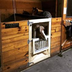 Half-stall door with a cut out for a miniature horse, which would be perfect for a barn with both horses and ponies as well as miniature horses