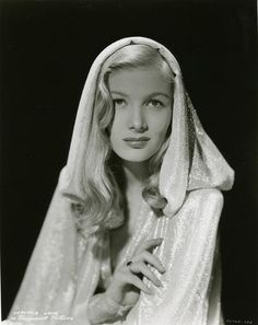 Veronica Lake poses in a beautiful hooded gown