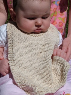 Knit Bib Pattern -- the look is a little more gender friendly and less frilly than others I've seen