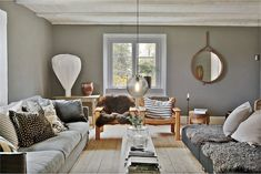 Sitting room with earthy green walls and mid-century furniture in a charming 19th century house on Gotland
