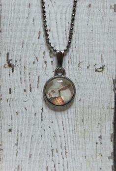 The White Rabbit from Alice in Wonderland charm necklace.    Simple typewriter key style charm measures 1/2 inch in diameter on 1.5 mm 20 inch