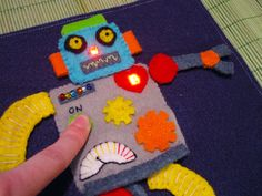 Quiet books, welcome to the century! I've wanted to create a robot page ever since I learned what a quiet book is. I'm very glad I waited so long to really think it through, becaus… Projects For Kids, Diy For Kids, Craft Projects, Sewing Projects, Crafts For Kids, Project Ideas, Smart Textiles, E Textiles, Arduino