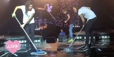Harry Styles does a bit of mopping at One Direction's Dublin OTRA show  - Sugarscape.com