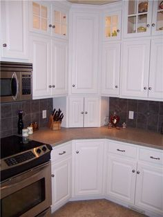 Upper Corner Kitchen Cabinet Ideas | Corner cabinets - upper, lower, and appliance garage - doors closed