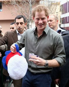 Prince Harry is presented with a Chile 'Beer hat' as he meets members of the public outside Valpariso Firestation on June 28, 2014 in Valpariso, Chile.