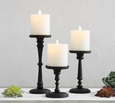 Light up your home with decorative candles and candle holders from Pottery Barn. Shop pillar, floating, votive and tea candles and candle holders in stylish colors and patterns. Wall Mounted Candle Holders, Mercury Glass Candle Holders, Hurricane Candle Holders, Wooden Candle Holders, Candle Holder Set, Black Candle Holders, Diy Candle Stand, Candle Stands, Rustic Candleholders