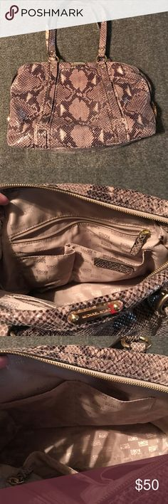 """Michael Kors Purse Gently used Michael Kors purse in a snakeskin color. Purse Size is 16"""" x 9"""" x 5"""". It has double straps at the top with a 9"""" drop. The straps have some wear on them (see pictures) Also see pictures for a scratch on the back of purse. Gold hardware, top zip closure, inside has 1 inside zipper, 4 open pockets and plenty of room. The material on the bag is very flexible/soft. Purse is authentic, I purchased this new from Dillard's. If you have any questions, please ask…"""
