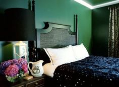 emerald green walls. love the sparkly duvet too. very glam.