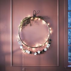 DIY - Advent Calendar for Adults - A hula hoop decorated with lights, greenery and paper stars hangs from a wall. Ikea Christmas, Christmas Holidays, Christmas Wreaths, Christmas Crafts, Christmas Decorations, Holiday Centerpieces, Advent Calenders, Diy Advent Calendar, Advent Calendar Ideas For Adults