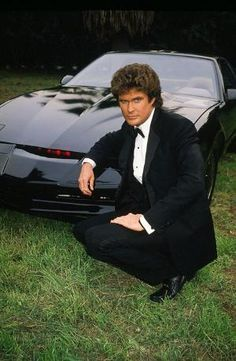"""Michael Knight (David Hasselhoff) and the Knight Industries Two Thousand (KITT, voiced by William Daniels) in """"Knight Rider."""" Who says friendship has to be between two human beings?"""