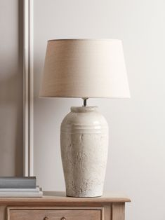 With a distressed pitted surface to the crackle glaze, and a gentle ribbed detail, our table lamp will bring a timeless style to your space, and an authenticity to your scheme. The natural cotton shade has a classic tapered shape, finishing the silhoue Table Lamps Uk, Retro Table Lamps, Large Table Lamps, Ceramic Table Lamps, Light Table, Lamp Light, Grande Lampe, Contemporary Table Lamps, Fashion Lighting