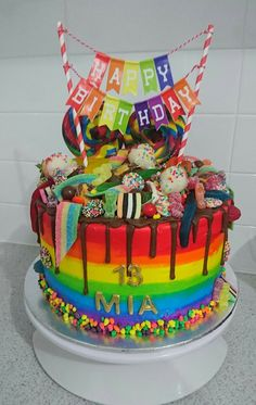 Rainbow lolly drip cake