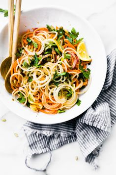 Zesty Carrot Celeriac Spiralized Salad! A light spiralized salad that is quick and delicious! Simply marinade the vegetables noodles in homemade dressing then garnish and serve. This healthy salad is ready in under 30 minutes. Paleo, vegan, and low carb too!