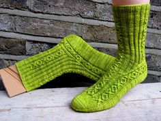 Ravelry: Love and Liquor pattern by General Hogbuffer free. I love that these could be mens socks but his designs also have colour.