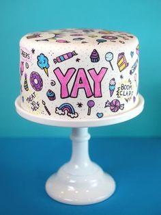 O site da Bakerella é recheado de coisas lindas, fofas, delicadas e feitas com perfeição. Mas essa de hoje é nota dez: decorar um bolo com canetinhas. Clar