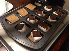 For a quick Smores fix, grab your brownie pan and put 1 graham cracker in the bottom of each well, top with a marshmallow, chocolate piece and another cracker. Pop in the oven at 400 for 6-7 minutes (watch for the marshmallow to melt) Let sit for a few minutes so it can set and it won't be so difficult to take out. I use my brown Nylon Pan scraper to pop them out. Happy Eating!