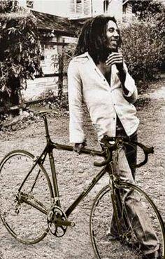 Mr. Bob Marley with a bike.