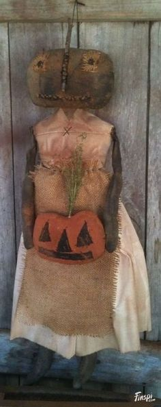 Primitive Black Folk Art Pumpkin Doll with her .