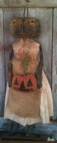 Primitive Black Folk Art Pumpkin Doll with her .