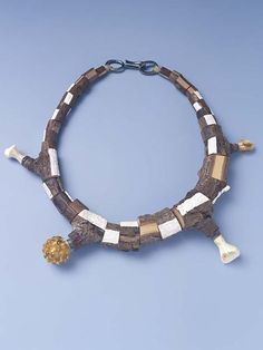 Terhi Tolvanen ~Untitled 2004. Necklace Ø 18 cm. Wood, paint, silver, glass, amber. Private collection.