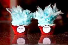 Thing 1 & Thing 2 Cupcakes - red cupcake liners, white icing, and blue cotton candy on top.  How cute?!