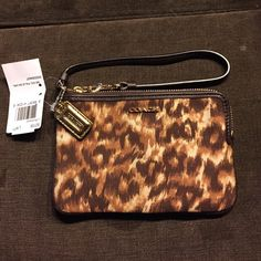 SALE TODAY ONLY Coach ocelet wristlet Coach ocelet wristlet measures 6 1/4 x4 1:4 Coach Bags Clutches & Wristlets