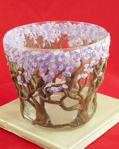 is a glass vase or candle holder cover with by Fatbottomponies