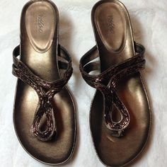"""Mossimo Copper-Colored Wedge Sandals Pretty copper-colored wedge sandals with copper-colored bead accents. 3"""" wedge 1/2"""" platform. That is a depression mark on the left shoe by the toe separator (see pic 1), from closet clutter. Gently worn, 1-2 times maybe. Mossimo Shoes Wedges"""