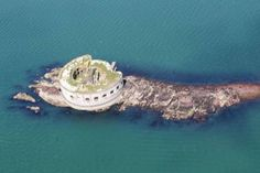 A fixer-upper with a difference: Welsh island with Napoleonic fort is cheaper than an average London flat Unusual Buildings, Unusual Homes, Water Tower, Fortification, Medieval Castle, Flats, Island, London, Welsh