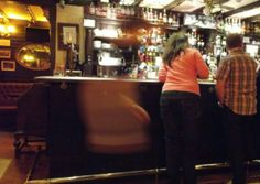 Paranormal investigators at Edinburgh pub The White Hart Inn have taken another photo of what appears to be a ghostly apparition in in the bar.   The picture, taken by Edinburgh Ghost Hunting Society (EGHS), comes after a tourist's photo showed a similar figure in the foreground late last year, which prompted an investigation by the Psychical Research and Investigation Unit - part of the Sir Arthur Conan Doyle Centre (SACDC).