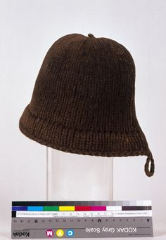 Only known original Monmouth cap (16th century). Appropriate for 16th - 18th century. Knitted in two-ply brown wool, with an approximate gauge of 1 stitch per centimeter.