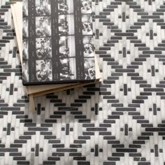 Esparto, a hand-cut tumbled mosiac, shown in Nero Marquina and Calacatta , is part of the Tissé® collection for New Ravenna. Tile Accent Wall, Wall Tiles, New Ravenna, Calacatta, Mosaic Designs, Weaving Techniques, Texture, Holiday Decor, Home Decor