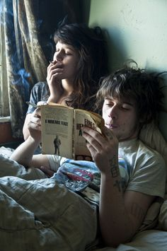i could see this happening :} but me reading, and him smoking haha