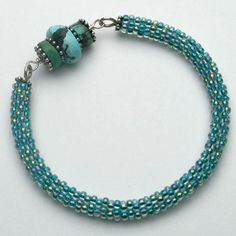 Dottie Hoeschen's Round About seed bead bracelet is a great first project for those who are new to brick stitch.