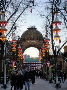 Tivoli Garden's Main Entryway, Copenhagen. Tivoli Gardens is a famous amusement park and pleasure garden in Copenhagen, Denmark. The park opened on August 15, 1843, and is the second oldest amusement park in the world.