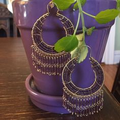 """Bohemian beaded Earrings Beautiful bohemian earrings with gold and purple beads. They are gorgeous and make a statement. They hang to 3"""" long and are about 1 1/2 """" wide. Jewelry Earrings"""