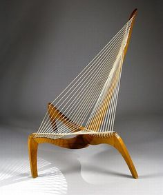 """A rare """"Harp"""" or """"String"""" chair, designed by Jorgen Hovelskov, 1968, for Christensen & Larsen/Denmark, flag line, height 127 cm, depth 117 cm, width 104 cm, height of seat 40 cm. The curved shapes of the legs are reminiscent of Viking boats. These and the tightened ropes provide this chair with an impressive sculptural quality."""
