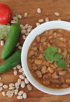 Charro beans! Pinto beans slow cooked with bacon, peppers, tomatoes and garlic