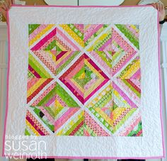 Oh, I love this sweet string quilt for a baby girl!!! Would be nice in other colors for a boy, as well!