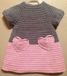 """I like the idea of crocheting a heart and making it into a pocket on a fabric shirt/skirt/dress. [ """"Soft & Beautiful Crocheted Pink and Grey Baby Toddler Dress Heart Pockets…"""", """"Color idea only."""", """"Lily by Michael Sodeau for Modus"""" ] # # # # # # # # # Crochet Girls, Crochet Baby Clothes, Crochet For Kids, Knit Crochet, Crochet Children, Baby Patterns, Knitting Patterns, Crochet Patterns, Baby Sweaters"""
