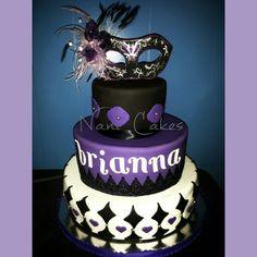 Black and purple mascarade fondant cake.  Mask had made yours truly.  Nanicakes