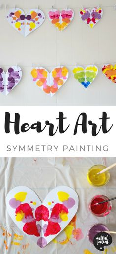 Heart symmetry painting with kids. Fun art project for Valentine's Day!