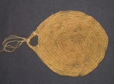 Nålbinding is a knotless netting technique.  This piece is a milk strainer made of cow tail hair and featured in the Vesterheim Norwegian-American Museum collection.