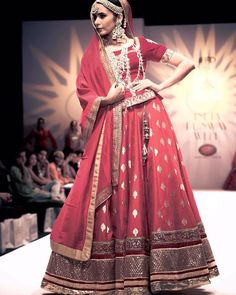 This fabulously red outfit by @megha_and_jigar at the #Indianrunwayweek #meghajigar #designers #lehenga #red #isf #indianstreetfashion #morviimages Courtesy: @morvi_images